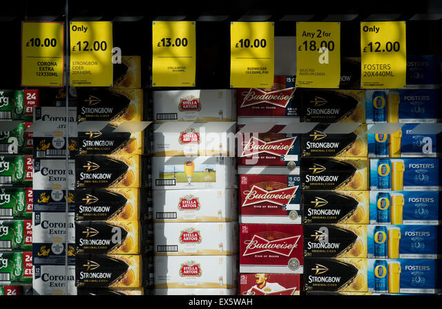 Cheap alcohol for sale in a supermarket window. - Stock Image