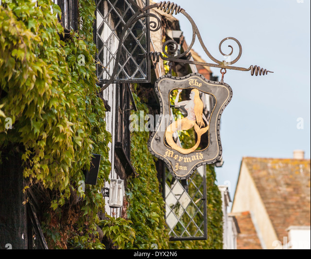 Sign of the Mermaid Inn in Rye, East Sussex, UK, outside ivy-clad wall - Stock Image
