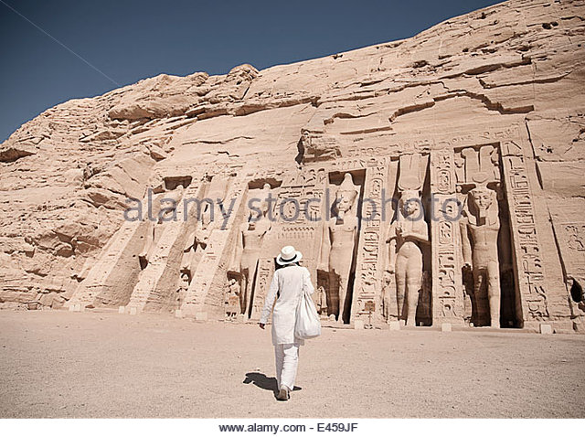 Female tourist at Abu Simbel, The Rock Temple in Nubia, Southern Egypt commemorating Pharaoh Ramesses II and Queen - Stock Image