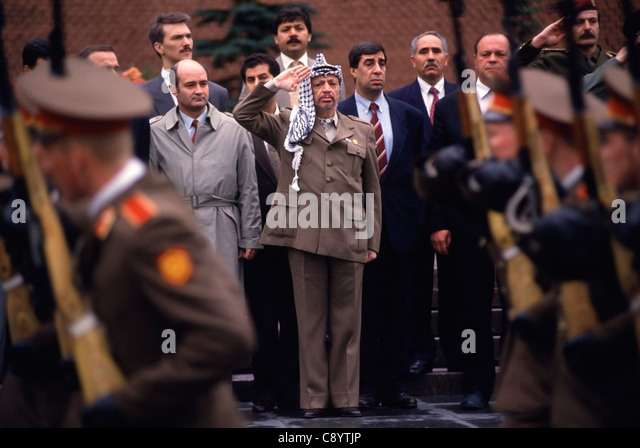 Yasser Arafat (1929-2004) salutes a Russian honor guard during his 1994 visit to Moscow, Russia. - Stock Image