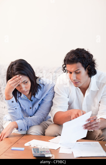 Couple talking about bad news they got by mail - Stock Image