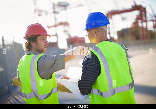Construction workers talking on site - Stock-Bilder