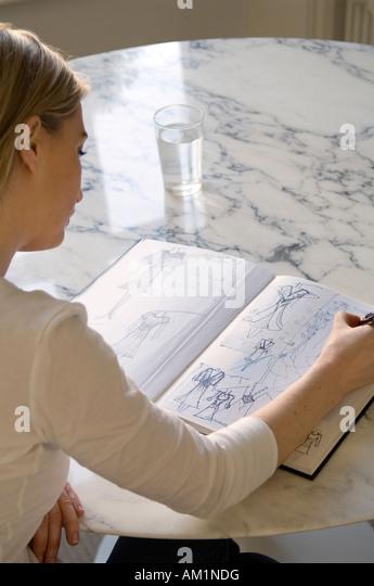 Fashion designer at work - Stock-Bilder