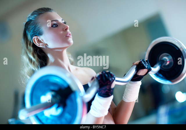 Weight training young woman portrait. - Stock Image