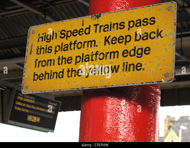High Speed Trains pass this platform sign, keep back from platform edge at Warrington Bank Quay Railway Station, - Stock Image
