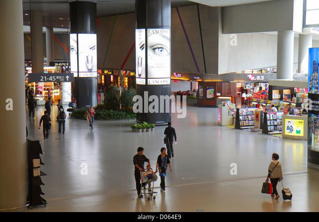 Shanghai China Changning District Hongqiao Airport Terminal 2 SHA concourse gate area Mandarin symbols hanzi English - Stock Image