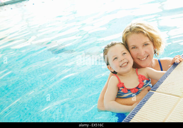 Mother and Daughter in Indoor Swimming Pool - Stock Image