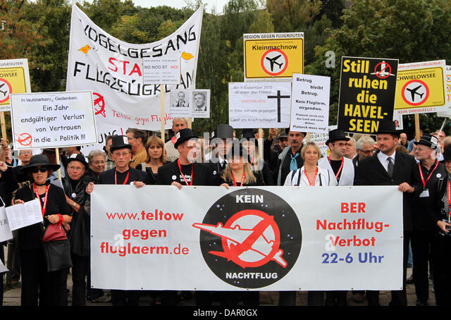 About 150 demonstrators hold banners during a street protest against noise pollution from BBI airport in Potsdam, - Stock Image