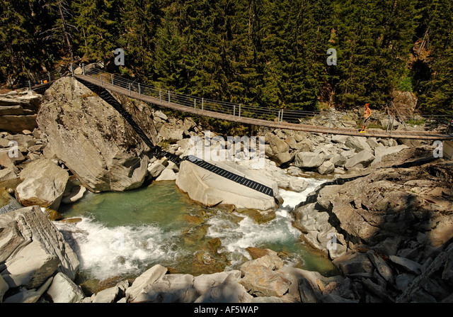 Switzerland Canton Graubuenden suspension bridge over the Unterrhein - Stock Image