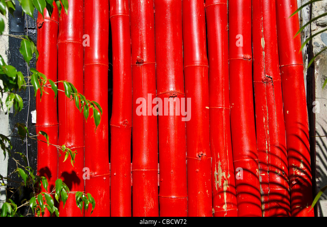 bright red bamboo covering window, Roseau Dominica in the Eastern Caribbean - Stock Image