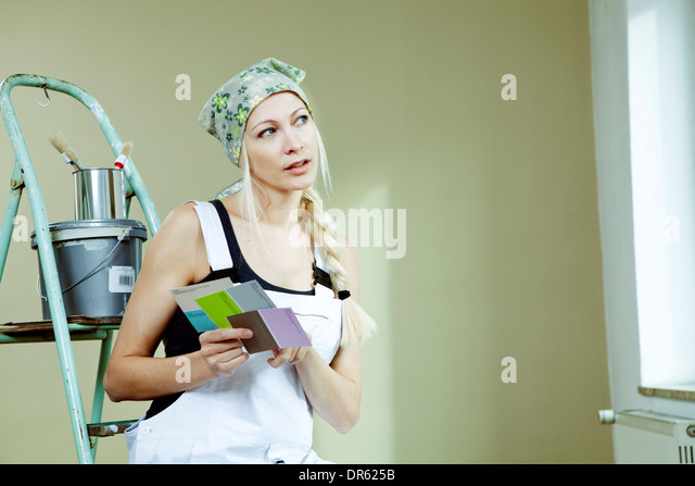 Young woman holding color samples, Munich, Bavaria, Germany - Stock Image