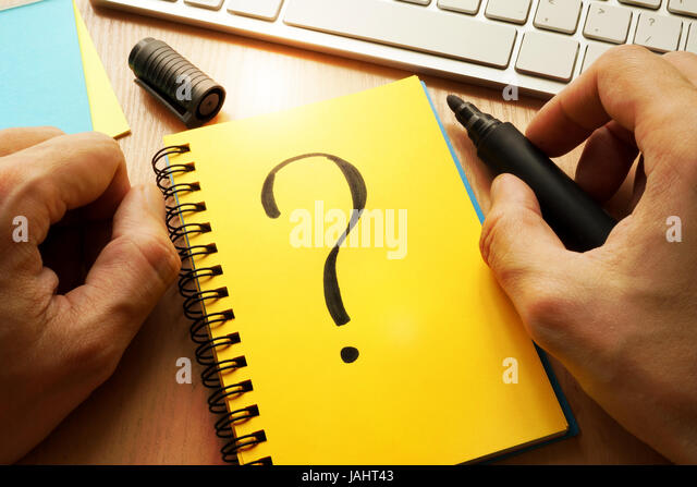 Question mark written in a note. Choice concept. - Stock Image
