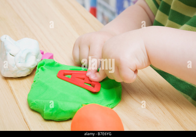 Child with modelling clay - Stock Image