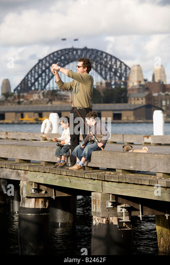 Father and Sons Fishing Pyrmont Point Park Sydney New South Wales Australia - Stock Image