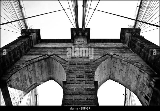 USA, New York City, Lower East Side, Part of Brooklyn Bridge seen from below - Stock Image