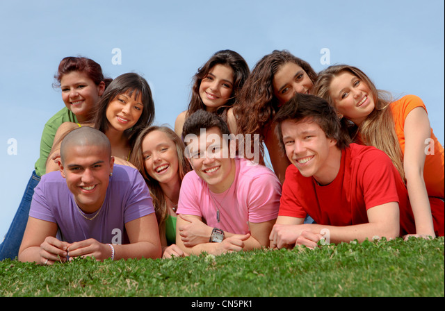group of diverse teens at summer camp happy and smiling - Stock Image