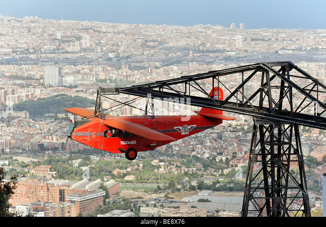 The nostalgic red plane ride simulator Avio in Tibidabo amusement park. Barcelona Spain. - Stock-Bilder