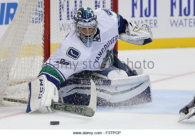 Anaheim, CA. 12th Oct, 2015. Vancouver Canucks goalie Ryan Miller #30 makes a stick save in the third period in - Stock-Bilder