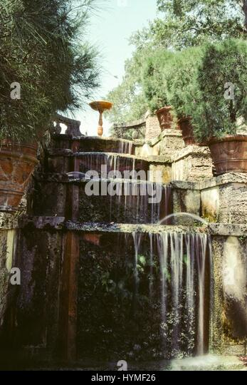 Waterfall and decorative carvings in Fairchild Garden, Miami, Florida, 1985. - Stock Image