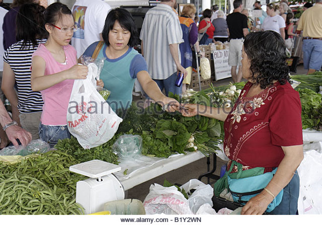 Little Rock Arkansas River Market Farmers Market buyers sellers Vietnamese Asian woman women girl mother daughter - Stock Image