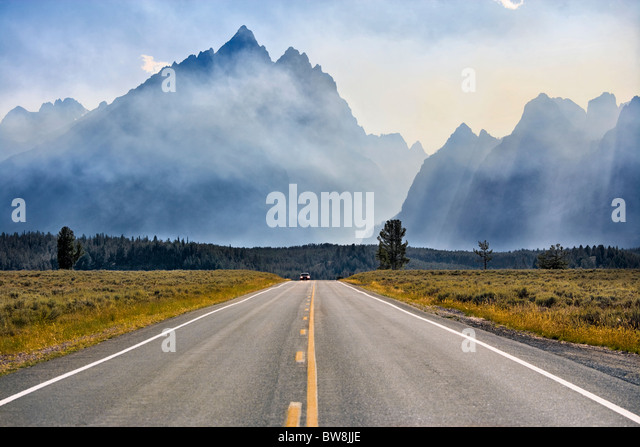 Mount Teton in Grand Teton National Park Wyoming. Jenny Lake Loop Road Scenic byway. Smoke from controlled fires. - Stock Image