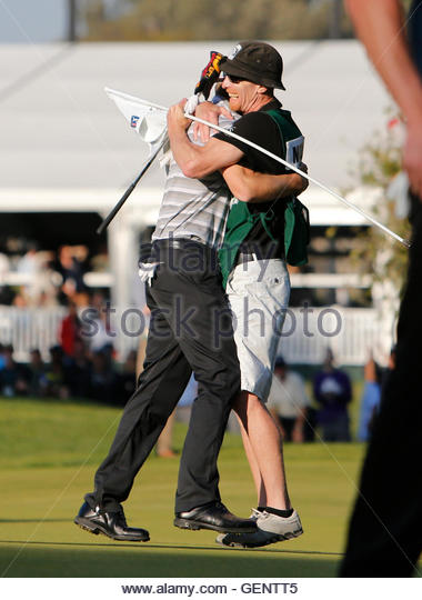 John Merrick of the U.S. hugs his caddie Ryan Goble as he celebrates winning the Northern Trust Open golf tournament - Stock Image