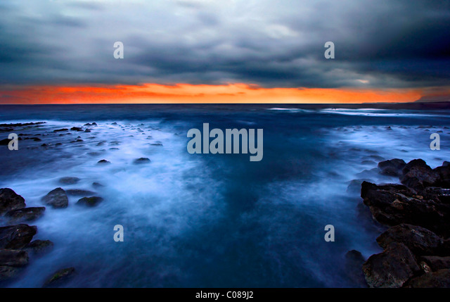 Sunset photo from the breakwater of the old Venetian port of Hania, town, Crete, Greece. Long exposure shot. - Stock Image