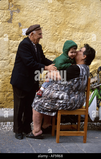 Greece Isle of Rhodes Old Town Jewish Martyrs Quarter medieval district residents grandparents child - Stock Image