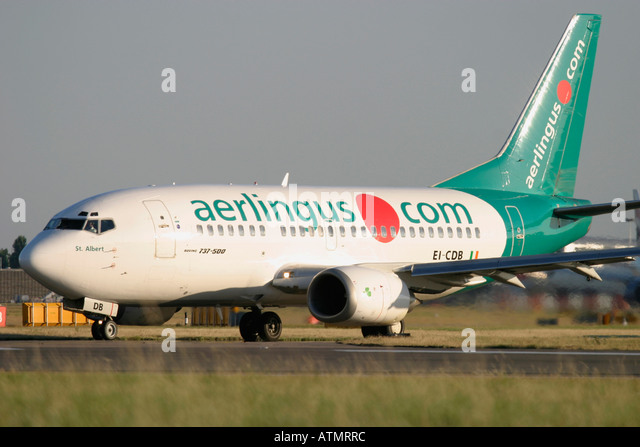 Aer Lingus Boeing 737-548  at London Heathrow Airport - Stock Image
