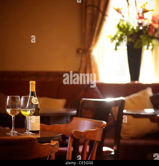 wine and glasses on a table in a pub / bar - Stock Image