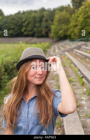 Young girl in hat outdoors. - Stock Image