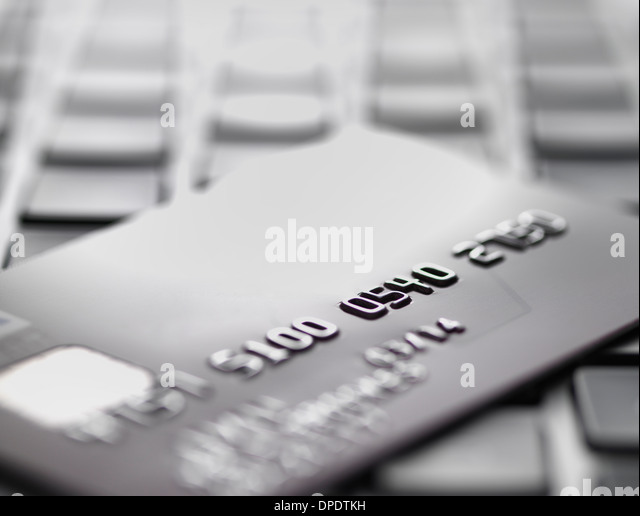 Credit card on laptop to illustrate internet shopping and internet fraud - Stock-Bilder