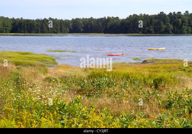 Maine Brunswick Maquoit Bay scenery scenic canoes water grass - Stock Image