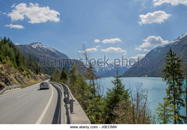 "Driving along Lake Achensee often called the ""Fjord of the Alps"" - beautiful at every time of the year. - Stock Image"