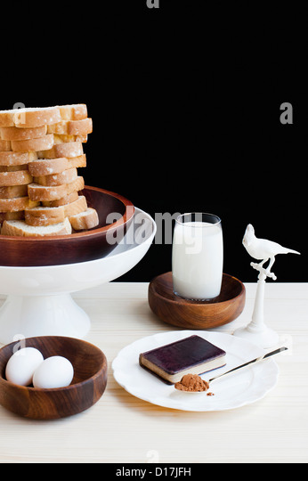 Dessert with milk, eggs and bread - Stock Image