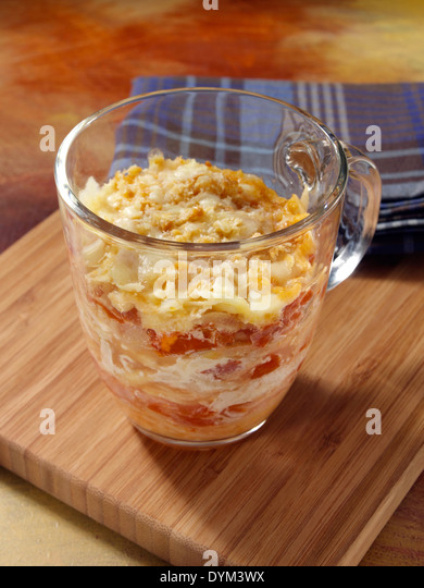 Parsnip tomato slices cooked in a mug - Stock Image