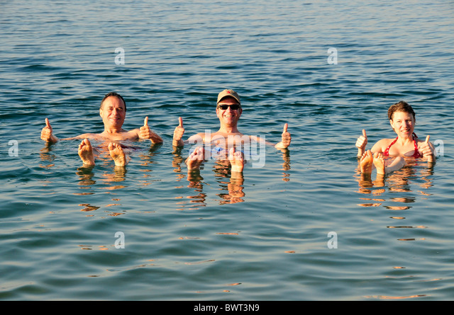 Tourists, thumbs-up, in the Dead Sea near Suwaymah, Jordan, Middle East, Orient - Stock Image