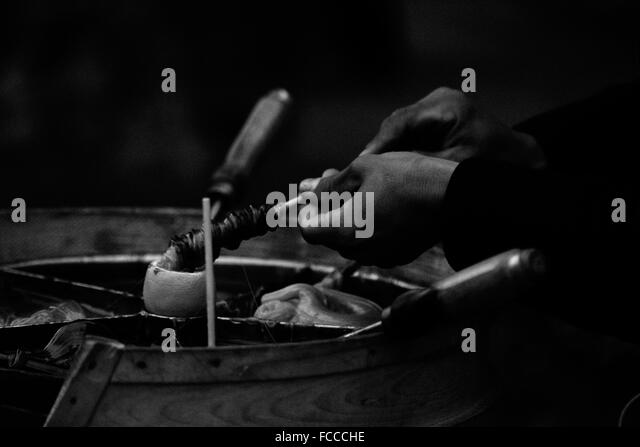 Detail Shot Of Hand Preparing Eatable For Sale - Stock Image