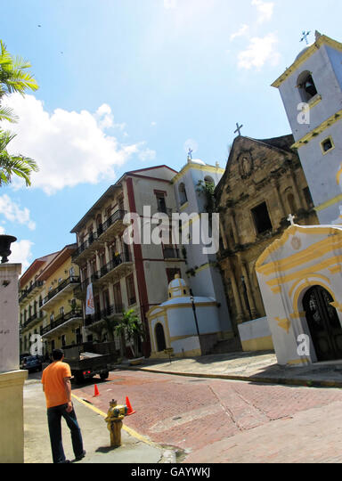 Old church, classic buildings and brick or cobblestone street in Casco Viejo, Panama. - Stock Image