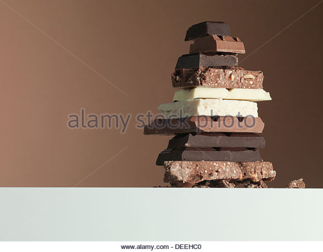 Stack of chocolate bars - Stock Image