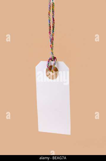 hanging label with colorful string - Stock Image