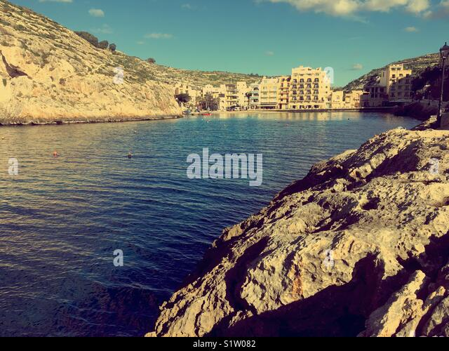 Village of Xlendi, Gozo, Malta from bay leadin to open sea - Stock Image