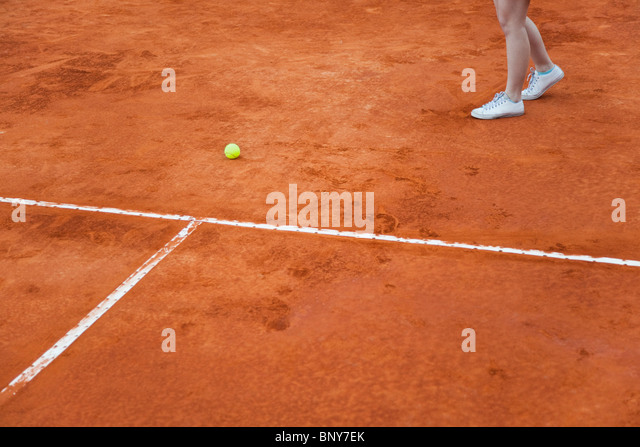 Tennis player approaching missed ball, cropped - Stock Image