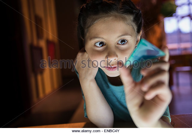Curious girl holding geometric shape at science center - Stock Image