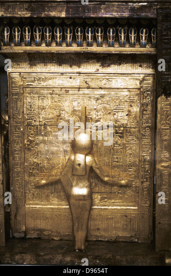 Tutankhamun (Tutenkamen) d.c.1340 BC 18th dynasty Egyptian Pharaoh. Guardian figure on his golden sarcophagus. - Stock Image