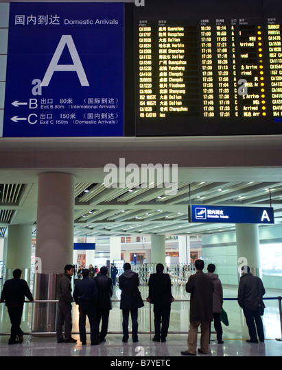 Domestic Arrivals flight information electronic display board at new Beijing Airport Terminal 3 China 2009 - Stock-Bilder