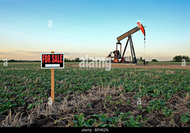 Pump jack with for sale sign. - Stock Image