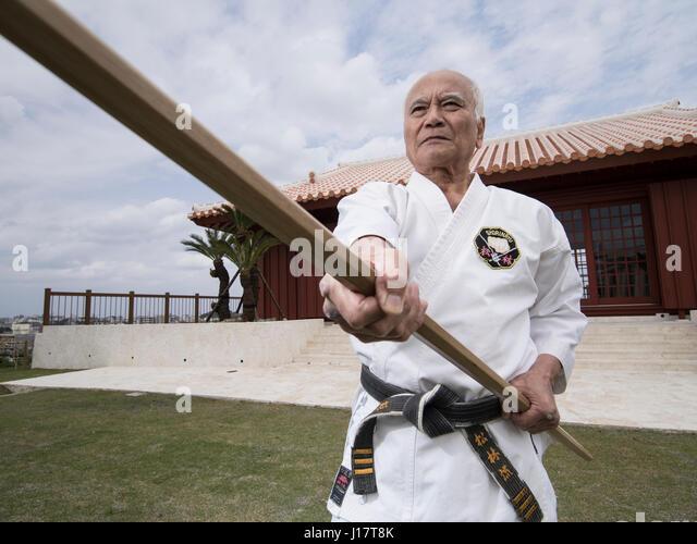 Karate master Arakaki sensei at the 100 Kobudo Kata Event at Karate Kaikan, Okinawa, Japan - Stock Image