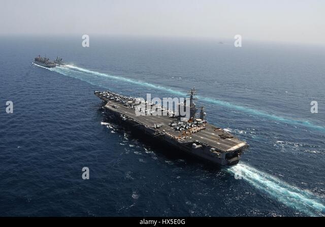 Aircraft carrier USS Dwight D. Eisenhower (CVN 69), Military Sealift Command fast combat support ship USNS Bridge - Stock Image