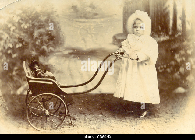 Cabinet photograph of toddler with pushchair and doll - Stock-Bilder